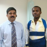 Dr. Subodh Shetty with patient in Nigeria